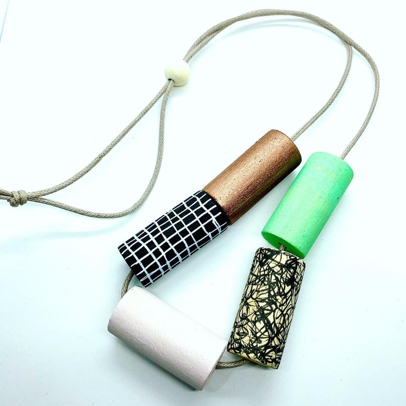 Statement monochrome pattern necklace with hand painted green and pale pink cylinder beads