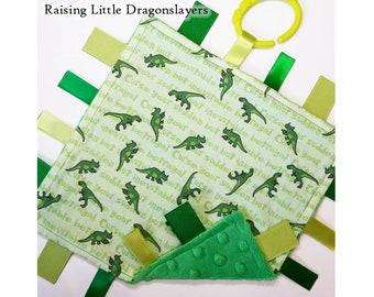 "Firefly / Serenity - Ribbon tag blanket made w/ Firefly / Serenity ""Inevitable Betrayal"" dinosaurs print, infant sensory toy, baby blanket"