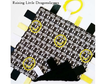 "Ribbon tag blanket made w/ Sherlock ""bored"" smiley on wallpaper print, infant sensory toy"