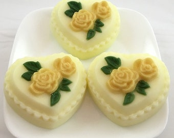 Decorative heart-shaped soaps accented with roses