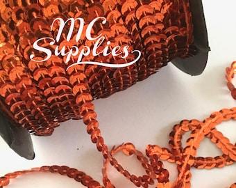 Orange Single Strand Faceted Sequin Trim 80 yard full spool