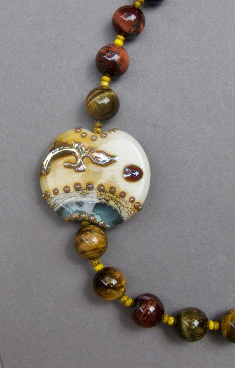 Unique and Beautiful Lampwork focal bead set off by Tiger/'s Eye beads with Silver Open Work Patterned Clasp