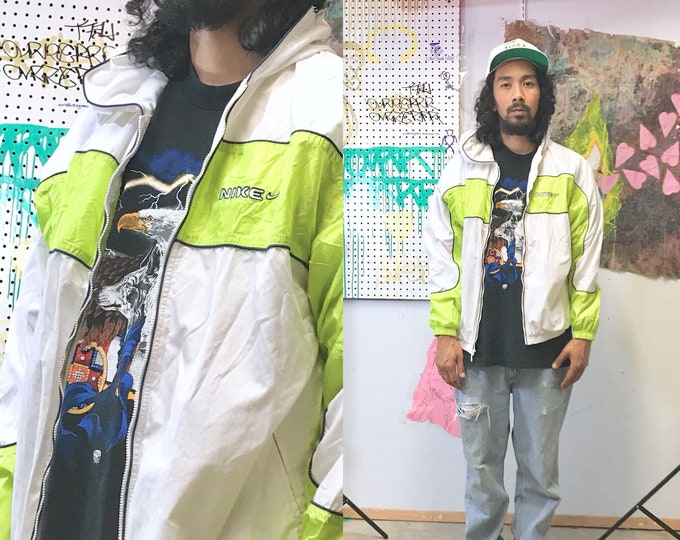 Featured listing image: Vintage nike windbreaker jacket 1990's green neon raver athletic white