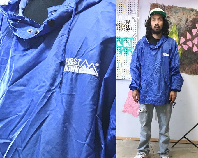 Featured listing image: Vintage first down rain poncho hoodie hip hop wu tang nyc 1990's vintage windbreaker blue XL