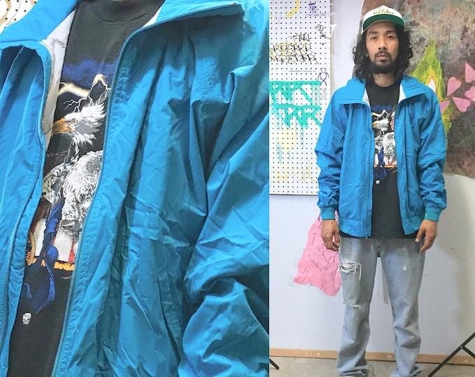 Featured listing image: 1980's helly hansen XL teal windbreaker jacket streetwear seinfeld hiking vintage jacket