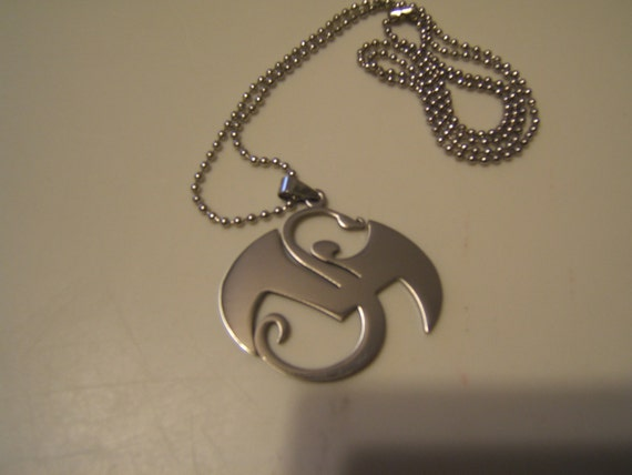 Tech n9ne strange music stainless steel pendant with a 30 inch etsy image 0 aloadofball Gallery