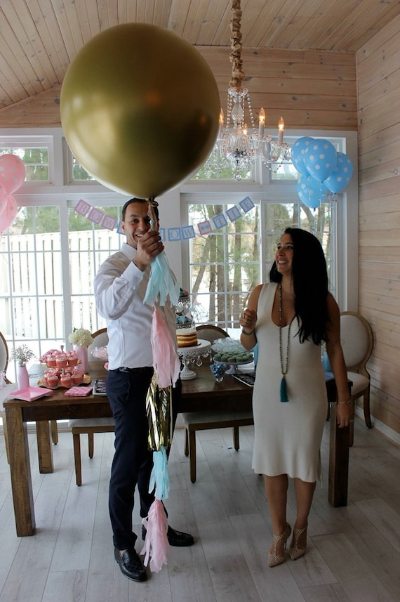 Gold Gender Reveal Balloon With Pink Blue And Gold Tassels