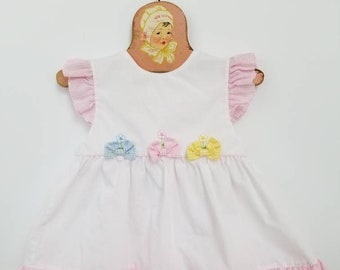 Vintage floral accented pinafore. Approx size 6-12 months