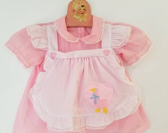Vintage pinafore accented baby dress. Approx  size 12-18 months