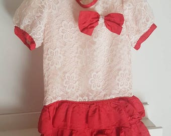 Vintage lace accented ruffled girls dress.  Made with in Canada