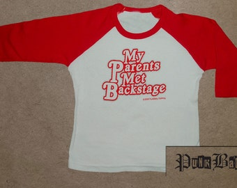 My Parents Met Backstage hand screen printed, red/white, kids baseball tee for Rolling Stone toddlers