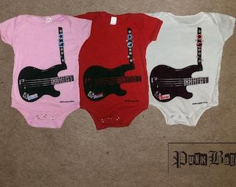 Rock Bass guitar for rockstar babies. Hand screen printed on a white onesie.