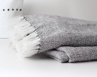 Black and white linen sofa throw with handmade fringes - minimalist Scandinavian style beach blanket - daybed cover by Linenspace | 0089