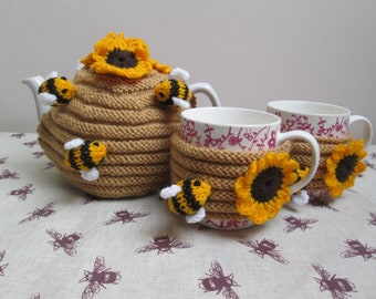Hand Knitted Sunflowers And Bumble Bees Bee Hive Tea Cosy With 2 Matching  Mug Hugs 8cd3455c1acf