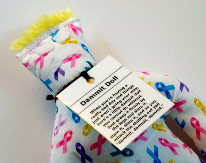 Cancer Dammit Doll, stress relief item on ribbon fabric