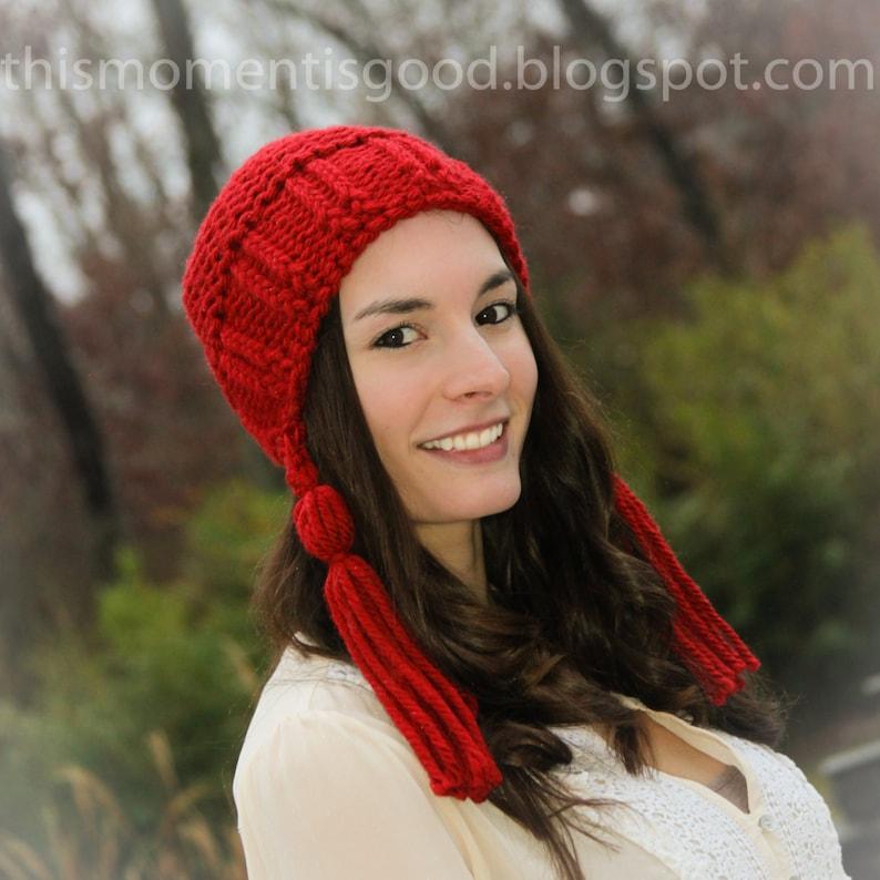 6a0be44024a Loom Knit Earflap Hat With Tassels Pattern. Loom Knitting PDF