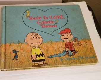 Vintage book You're in love charlie brown peanuts first edition