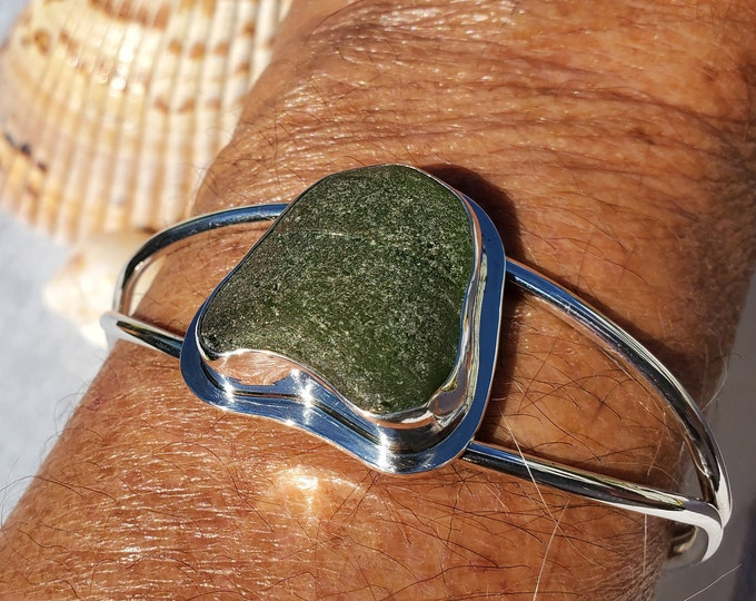 Black sea glass cuff bracelet, handcrafted, bezel set, using sea glass found by us on the beaches of Provincetown MA
