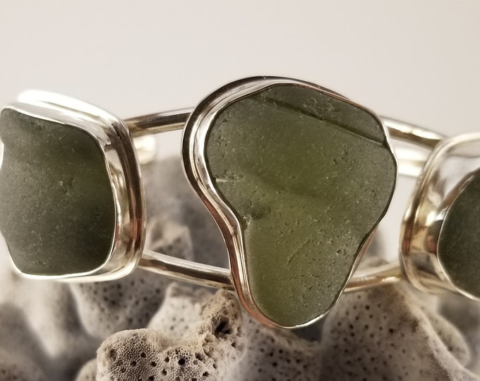 Sea glass cuff bracelet, adjustable, using olive green bottle tops found on the beaches of Provincetown MA