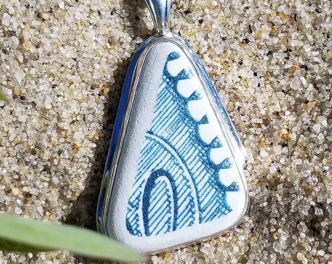 Blue and white pottery from the shores of Lake Erie, mounted in fine and sterling silver