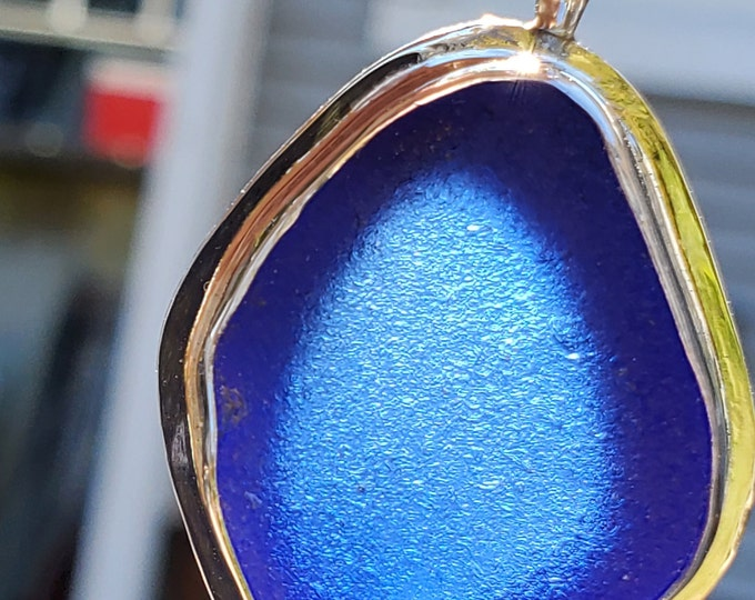 Cobalt blue sea glass pendant handmade from sea glass found by us and used as found on the beaches of Provincetown MA