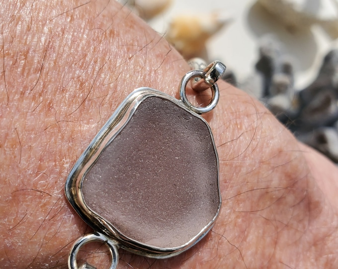 Purple sea glass bracelet, handmade, bezel set in fine silver, band is sterling silver, sea glass is from beaches of Provincetown MA