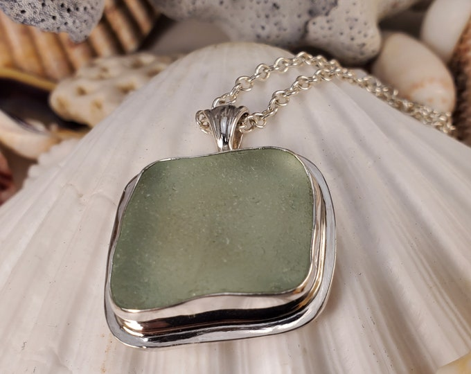Handmade sea foam sea glass pendant using sea glass found by us and used as found on the Beaches of Provincetown MA