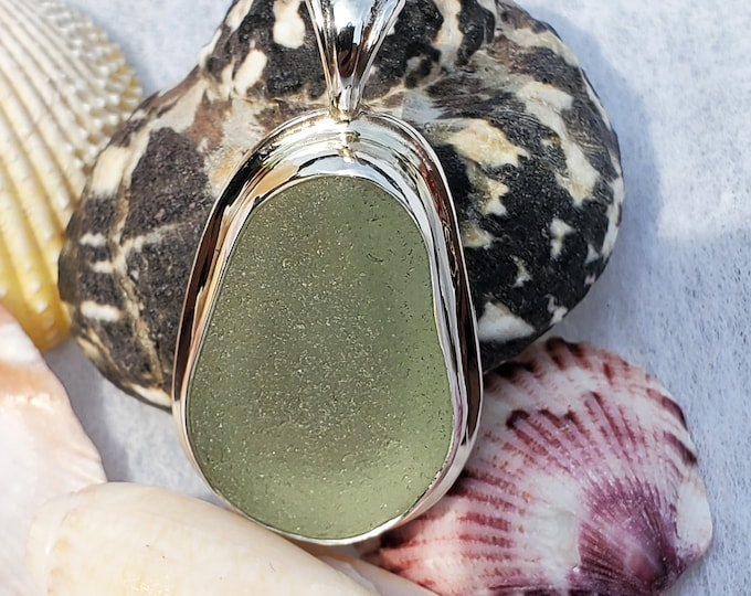 Handmade sea foam sea glass pendant, bezel set in fine silver and mounted on a base of sterling silver, the sea glass is from Ptown MA