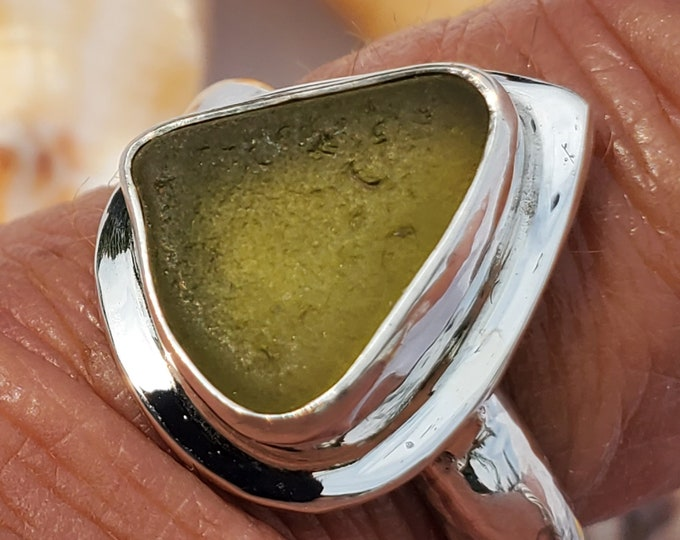 Olive sea glass ring handmade and bezel set, sold in and size and band style at no extra charge, the sea glass is from the beaches of ptown