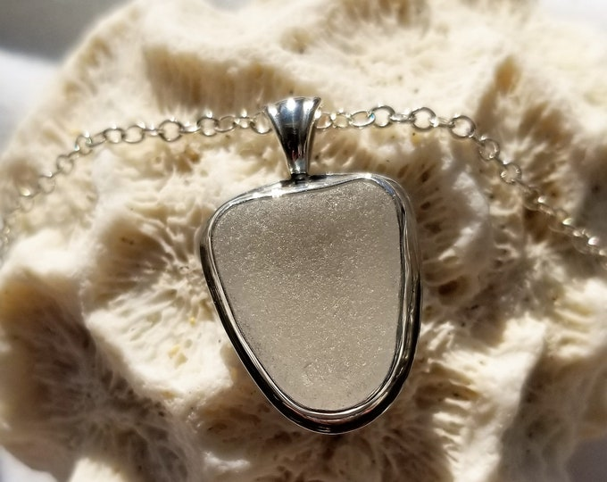 White sea glass pendant handcrafted in fine and sterling silver, The sea glass, found by us, is from the beaches of Provincetown MA