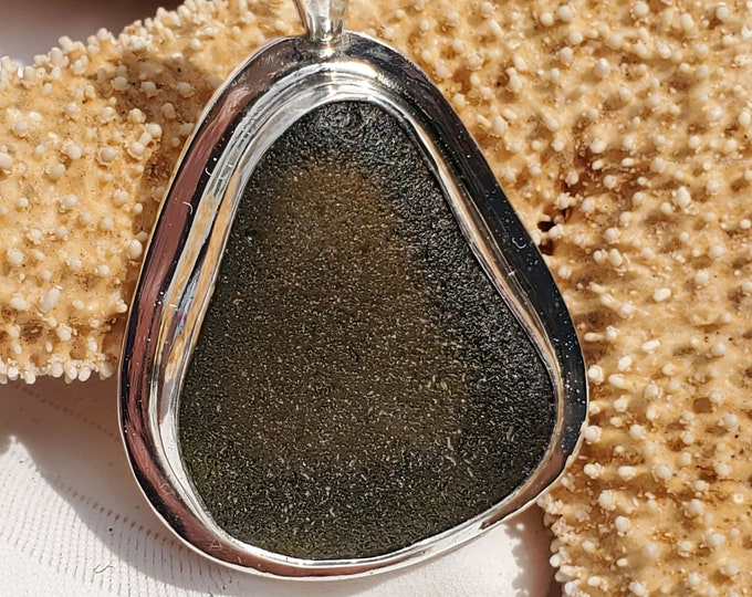 Olive/black sea glass pendant , bezel set, handcrafted using sea glass found by us and used as found on the beaches of Provincetown MA