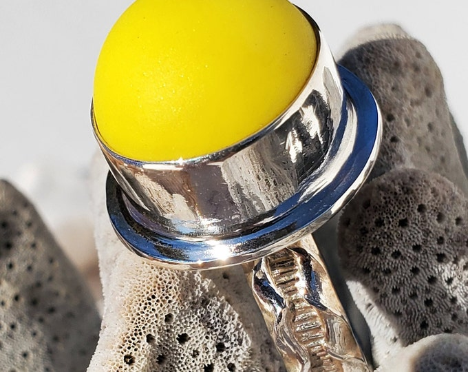 Yellow beach glass marble ring, bezel set in fine silver and mounted to a base and ring of sterling silver. Marble is from Lake Erie