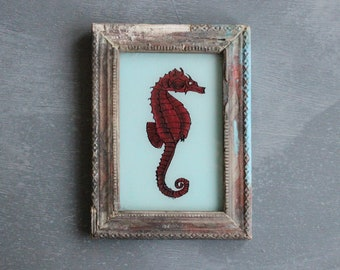 Charming vintage reverse glass painting from India folk naive art hand painted red seahorse rustic recycled hand made frame 14 x 18.5cm