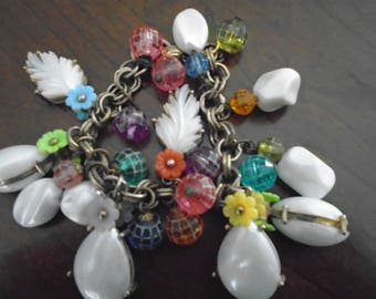 Vintage Plastic Charms flowers mother of pearl leaf charms gold tone bracelet. 7.5''