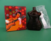 Avon Bottle titled Electric Guitar Decanter with box and cap still sealed in plastic from 1974