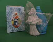 Avon Bottle Dutch Girl with Box and top is sealed in original plastic bag from 1973