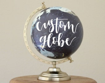 custom hand lettered calligraphy globe with gold or white lettering