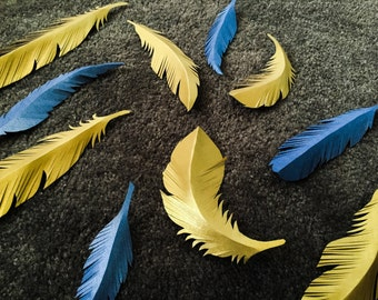 Hand cut paper feathers
