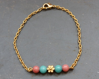 Bracelet with green and pink jade and flower bead
