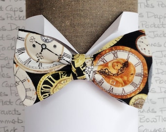 Clocks print bow tie in 100% cotton, pre tied bow tie, one size on an adjustable neck band.