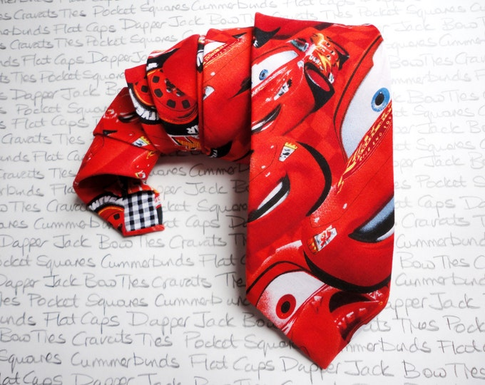 Neck tie in a cotton print from the film 'Cars' featuring Mater