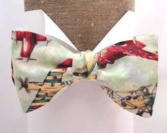 Bow Tie. Men's Bow Tie. Aeroplane print self tie or pre tied bow tie made in 100% cotton with an adjustable neck band.