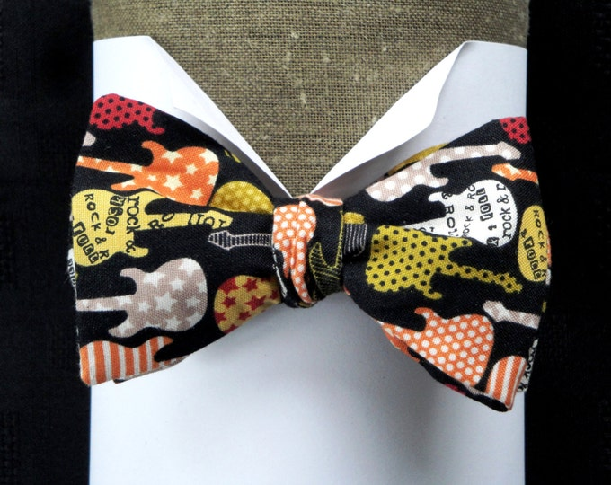 Bow ties for men, guitar print on black cotton, adjustable neck band to fit neck size up to 19.5 inches.