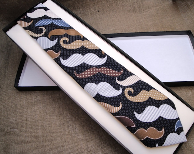 Novelty print skinny neck tie, lots of moustaches on a black background