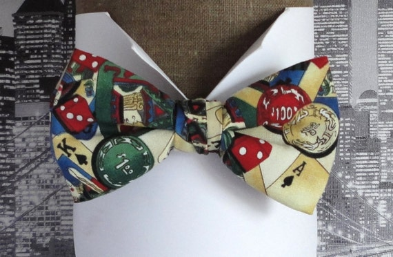 Bow tie, playing cards on a cream background, pre tied or self tie