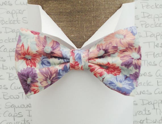Self tie or pre tied bow tie, flowers on an ivory cotton, adjustable neck band, will fit neck size up to 19.5 inches (48cms)