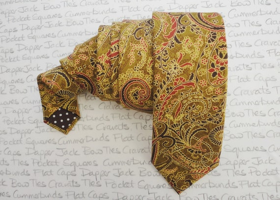 Paisley print neck tie in shades of gold and brown
