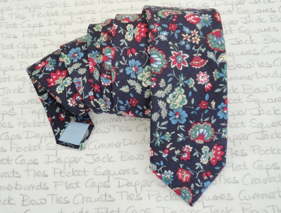Floral neck tie, burgundy, sage and pale blue floral pattern on a navy blue background