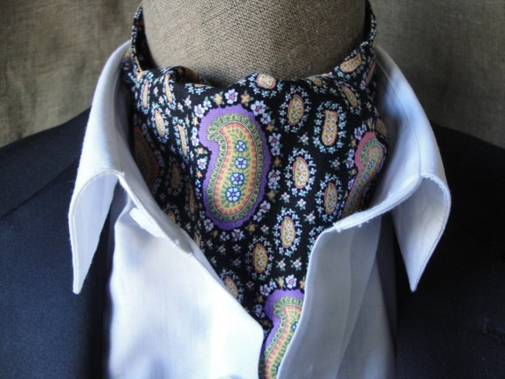 Paisley print cravat on black background.  One size fits all.