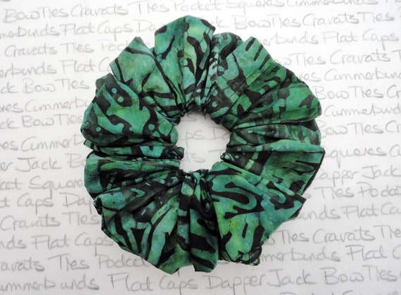Emerald Green Scrunchie, Green Leaves on a Black Batik Fabric, Generous Amount Of Fabric Ruched Into a Scrunchie Hair Accessorie